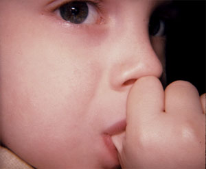 child sucking finger or Thumb